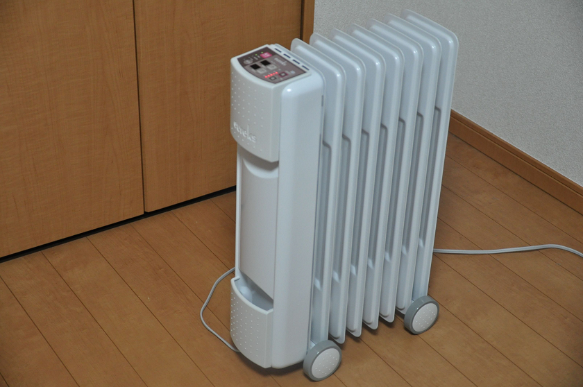 Eco friendly oil filled space heaters exude retro radiator for Eco friendly heaters