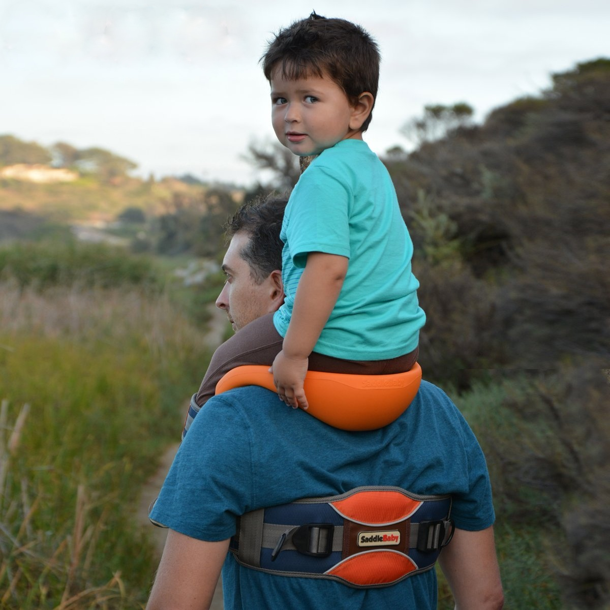 Saddlebaby allows for hands free shoulder rides for Daddy carrier