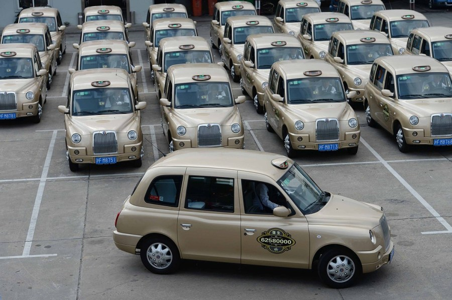AU My! 50 Gold Taxicabs Take To The Streets Of Shanghai