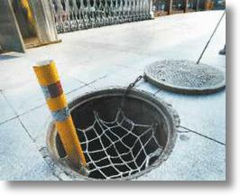 Safety Nets Keep Pedestrians Covered When Beijing Manholes Aren't