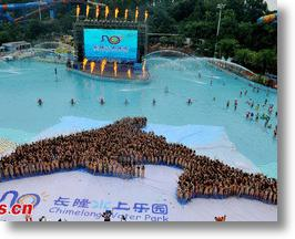 Thousands Of Bikini-Clad Girls Form Dolphin To Raise Environmental Awareness