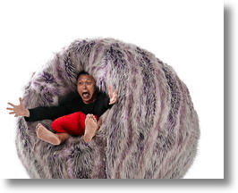 "Designer Jason Goh Being ""Eaten"" by his Monster Chair"