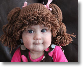 Baby Wearing a Cabbage Patch Style Yarn Wig