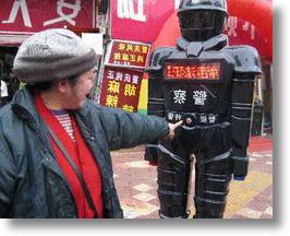 Chinese RoboCop Keeps An Electric Eye On Crime
