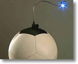 A SOCCKET Ball With An LED Light Plugged In