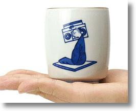 Traditional Japanese Porcelain Cups Mix Medieval Monks With Skateboards, Horse Masks & More