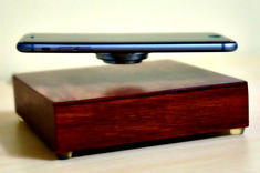 Smartphone levitating while charging on the OvRcharge