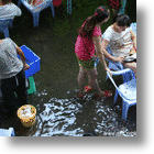 Chinese Restaurant In A River Serves Customers By The Brook