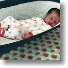 'Crescent Womb' Sleeping Device For Babies May Reduce SIDS