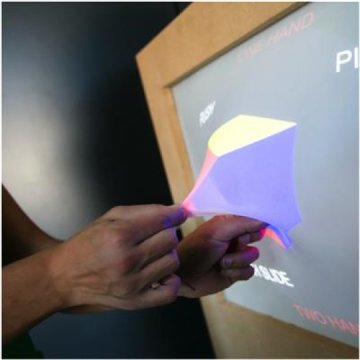 """GHOST display: this image shows the """"emerge"""" technology which allows on-screen data to be dragged out of the display. Image from GHOST."""