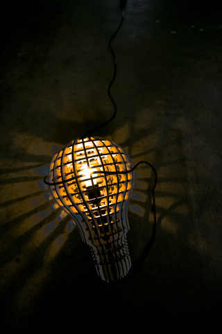 Wooden Bulb, leaving mysterious shadows in an otherwise dark room: design by Barend Hemmes