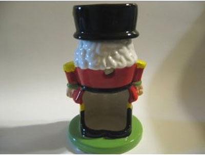 Nutcracker Candle and Tart Burner: The entrance for the tea light is usually in the back of the tart burner.