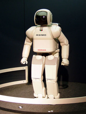 "Honda's ASIMO robot: one day robots like this may be biological-mechanical hybrids with bacterial ""brains"". Image taken by Gnsin at Expo 2005, in Japan."