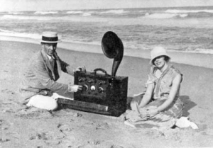 "Armstrongs with First ""Portable"" Radio"