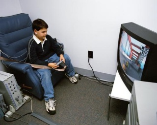 Teen uses prototype of Mindshift while playing videogame: image via physiologicalcomputing.com