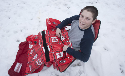 Zachary Smith with his Sports Snuggler: image credit: Mike Ransdell via kansascity.com