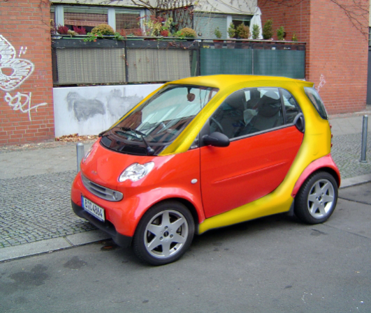 Smart car cozy coupe puts childlike fun back in driving for Little tikes motorized vehicles