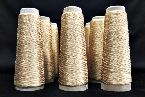 Synthetic spider silk thread in gold by Spiber: Thread for the new 'Moon Parka'