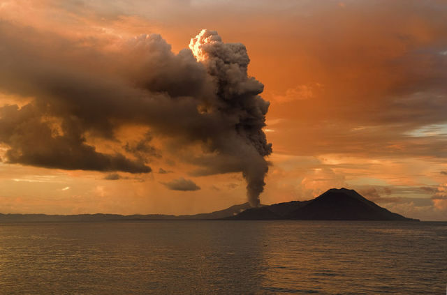 Erupting volcano: aerosol particles injected into the atmosphere by erupting volcanos have been shown to reduce global warming and coral bleaching. Image by Taro Taylor.