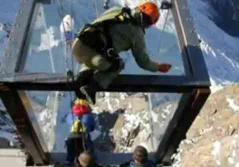 Workers on the Glass Box Suspended Over The Alps (You Tube Image)