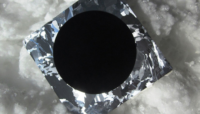 Black silicon: the color of this solar cell is indicative of its ability to absorb 99% of incident light making it a highly efficient photovoltaic. Image credit: Aalto University.