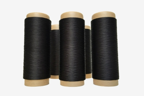 Synthetic spider silk thread in black by Spiber: Thread for the new 'Moon Parka'