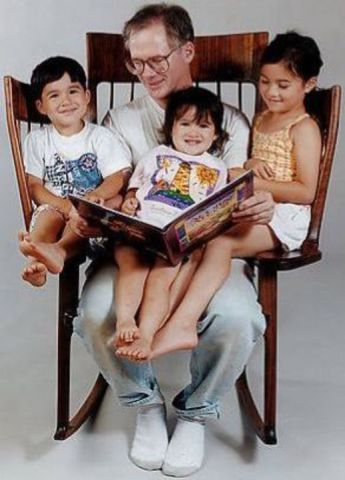 Taylor in the Storytime Rocker with his Kids (Image via Goods Home Design)