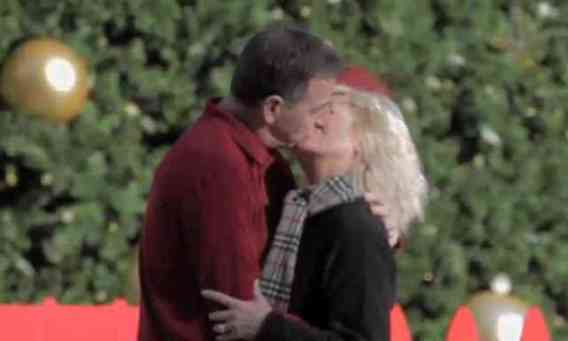 Couple Kissing Under the Mistletoe Drone (You Tube Image)
