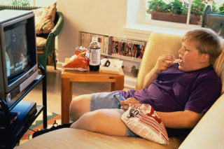 Overeating is a common response to stress among adults and kids.: image via dailymail.co.uk