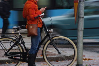 Woman Using Mobile Device on A City Street: Woman Using Mobile Device on A City Street