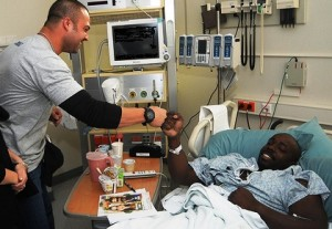 Healthcare worker fist bumps patient: image via medcitynews.com