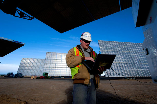 SolarTAC Technician Monitors the new CPV Generator: Image via NREL.gov