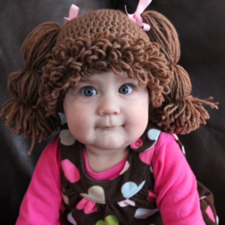 Baby Wearing a Cabbage Patch Doll Wig/Hat
