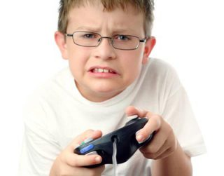 Cute kid, but is computer gaming good for him?: image via islandcrisis.net