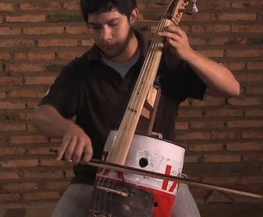 Juan Manuel Chavez Plays A Cello Made From Trash (You Tube Image)
