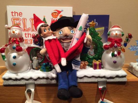 The Mensch on a Bench with The Elf on the Shelf (Image via Facebook)