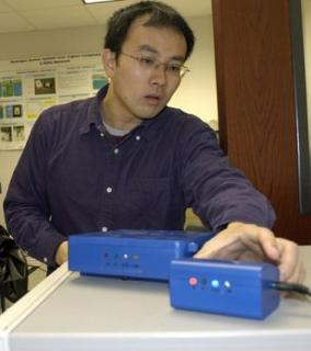 Changzhi Li shows the prototype baby monitor