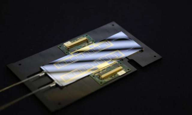 Optical chip: this novel chip allows previously complex and expensive experiments to be conducted cheaply and rapidly. Image from the University of Bristol.