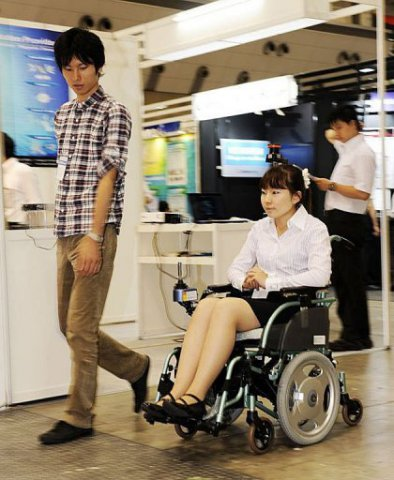 Robotic wheelchair follows its designated caregiver: image via amsvans.com