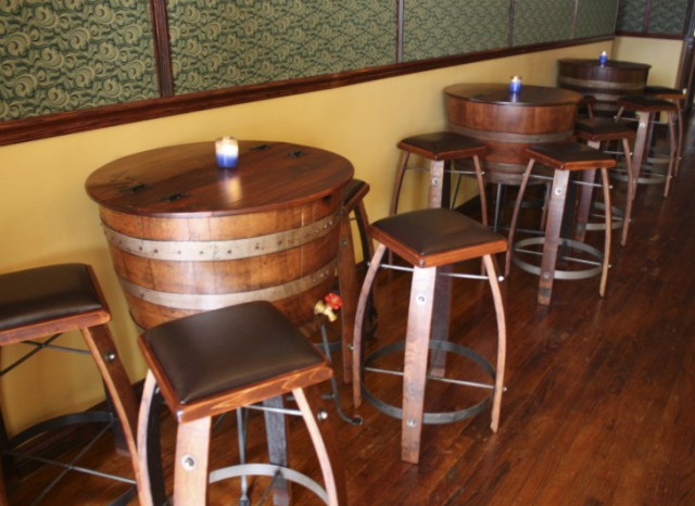 Tables and seating made from old wine barrels at ReVision Lounge in NYC: Photo via Inhabitat.com/NYC