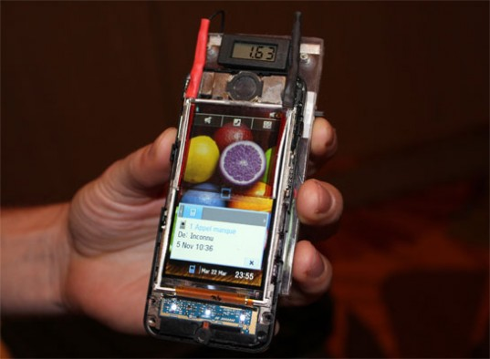 Wysips presents a transparent film that charges your cell phone using solar power: The other components seen in this image are NOT necessary for solar charging