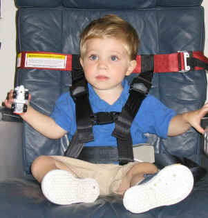 A child tries out his new CARES flight gear!